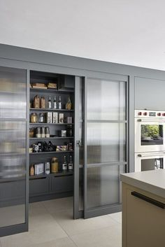 Translucent sliding doors to partially isolate .- Des portes coulissantes translucides pour isoler partiellement le cellier Translucent sliding doors to partially isolate the cellar - Kitchen Organization Pantry, Pantry Storage, Kitchen Pantry, Kitchen Storage, Pantry Ideas, Food Storage, Kitchen Taps, Storage Boxes, Organization Ideas