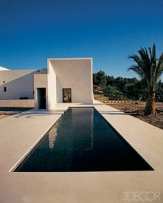 Lining a lap pool with dark bluestone gives it a powerful presence; the Ibiza, Spain, home is a finca with a minimalist addition by French architect Pascal Cheikh-Djavadi. Minimalist Architecture, Amazing Architecture, Contemporary Architecture, Interior Architecture, Langer Pool, Interior Tropical, Ideas De Piscina, Moderne Pools, Pool Water Features