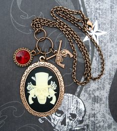 Guns and Roses pirate skull necklace with guns by SassyBelleWares