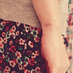 Wrist tattoo of a ribbon by Seoeon. Beautiful Small Tattoos, Cute Tiny Tattoos, Nail Tattoo, Wrist Tattoo, Ribbon Tattoos, Delicate Tattoo, Tattoos For Women, Tattoo Artists, Piercings