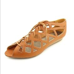 Mia Caged Sandal Fun sandals for the spring and summer! Laces are in this year and this is a fun spin on the trend. Gorgeous tan color, gently used, still in good condition. MIA Shoes Sandals