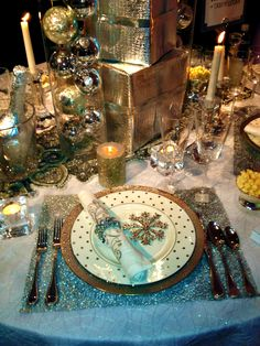 "like  some of the glittery ideas in this, but too Christmasy for us....  but I was at least looking at the wrapped ""silverware"" or napkin...gives me the idea that you could wrap it in some kind of tinsel or something sparkly"