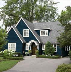 Blue and White Cape Style House blue home white house style architecture cape exterior design This is more English Cottage/Tudor Revival inspired than Cape Cod, with a bit of Colonial Revival in the doorway and windows. House Paint Exterior, Exterior Paint Colors, Exterior House Colors, Paint Colors For Home, Exterior Doors, Exterior Design, Gray Exterior, Exterior Houses, Bungalow Exterior