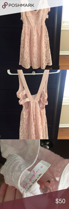 Blush pink free people lace Draco Free People- light blush pink, Lacey lightweight spring/summer dress. Very comfortable & cut out back. Sort of short dress so recommend wearing something spandex or something underneath. Wore for my graduation & received SO many compliments! *worn only once* Free People Dresses Mini
