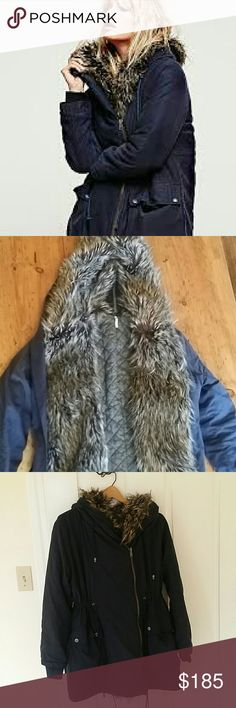 Free People Sweet Child Fur Hooded Parka Fits XS-M Excellent condition, super soft faux fur parka. Heavy weight and warm. The hood unzips down the middle for a more dramatic look. Adjustable waist. The size is extra small, but it's very oversized so it could definitely fit a small or maybe a medium. Free People Jackets & Coats
