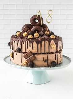 Cake for your birthday with donuts! - A birthday cake for the This is ideal for girls and boys! In our magazine you can see how you - 18th Birthday Cake For Guys, Chocolates, Salty Cake, Chocolate Donuts, Drip Cakes, Beignets, Savoury Cake, Cake Recipes, Cake Decorating