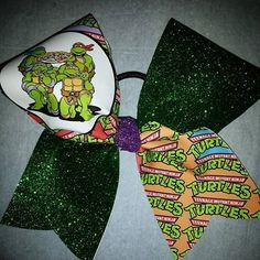 TMNT CHEER BOW DONE IN GREEN GLITTER WITH PURPLE GLITTER CENTER | bling on the bows custom cheer bows