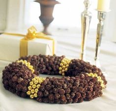 Gold jingle bells and petite pinecones make for a festive tabletop centerpiece!