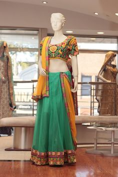 Embroidery: Mirror and Thread work  Fabric: Net skirt, Georgette Dupatta, and Raw Silk Blouse.  For more information please contact sales@sahil.com or visit us www.sahil.com