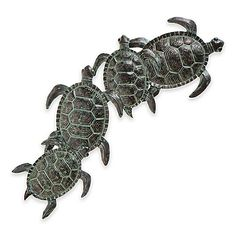 Bring a touch of the sea to your home with the Sea Turtle Wall Sculpture. These 4 turtles traveling together feature varying shades of green, while the durable metal construction stands the test of time as these turtles swim across your wall.