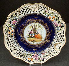 """Lovely~Antique~Ernst Teichert~Dresden Cabinet Plate There is a 1 3/4"""" reticulated border around the plate The center has a hand painted scene of lovers sitting in a garden under a tree~Th pierced border has panels with flowers alternating with scrolled decorations~It is all outlined in gold~Origin Germany Circa 1884"""