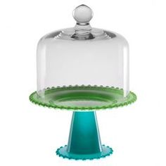 """Present delectable confections on this charming glass cake plate, featuring a clear dome and blue and green-finished base.    Product: Cake plate and domeConstruction Material: GlassColor: Green and blueFeatures: Beaded edgeDimensions: 11"""" H x 8.1"""" Diameter (overall)"""