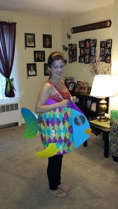 Rainbow fish Halloween costume. Poster board, cupcake liners and glitter!