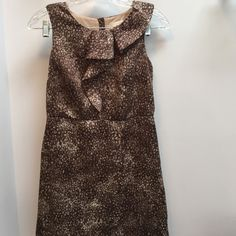 """Brown Loft Dress Brown dress worn a few times. I think it was washed instead of dry cleaned so there is some pilling but you can not see it unless you are super close like in the 4 th picture. 100% polyester lining and 100% polyester shell.length is 34""""  under arms across is 15"""" waist is 13"""" bottom across is 18"""" LOFT Dresses"""