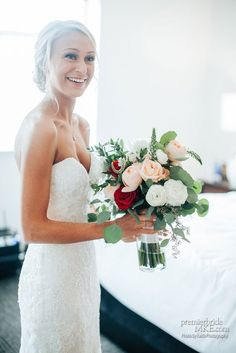 Bridal bouquet with red, peach and white flowers