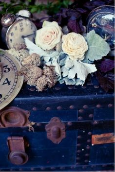 vintage trunk with flowers and clocks