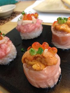 Ikura-Uni Sushi wrapped with aburi salmon.