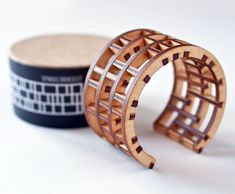 Modern Architecture on your Wrist: Spindle Bracelet by EVRT Studio: Made of 1/8″ thick birch plywood that is laser-cut and secured with a strong, but flexible glue, the pieces are situated in an intricately laid out plan, much like architecture.