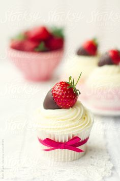 Cupcakes decorated with chocolate-dipped strawberries. Nice for Valentine's day.