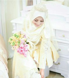 Pretty in soft yellow wedding outfit and love her bouquet too...(florabywawa)
