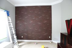 diy: faux brick wall with sheets from lowes/home depot.... and white washing it.