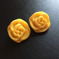 "Rose Clip-on Earrings Yellow rose earrings purchased from boutique in Brazil. Clip on. Plastic with metal backing. Approximately 1"". Happy to relist and price drop for chance at discounted shipping  Jewelry Earrings"
