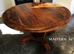 56″ Rustic Kitchen Table – Reclaimed Cedar Hydro Pole Base – 2″ threshing floor Hemlock top – Premium epoxy/matte polyurethane finish