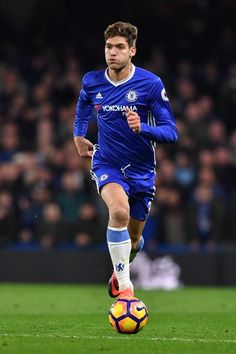 Chelsea's Spanish defender Marcos Alonso runs with the ball during the English Premier League football match between Chelsea and Tottenham Hotspur at Stamford Bridge in London on November 26, 2016. / AFP / Ben STANSALL / RESTRICTED TO EDITORIAL USE. No use with unauthorized audio, video, data, fixture lists, club/league logos or 'live' services. Online in-match use limited to 75 images, no video emulation. No use in betting, games or single club/league/player publications.  /