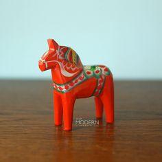 Swedish Nils Olsson Tiny Wooden Red Dala Horse. via Etsy.