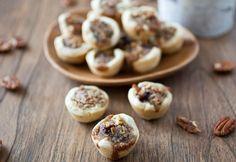 Miniature pecan pies with dark chocolate and a sweet bourbon-caramel filling.