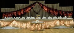 Icicle lights under head/cake table
