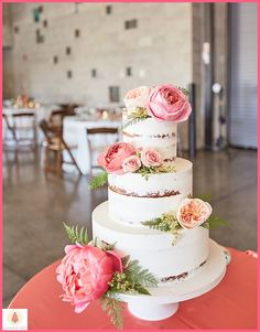 Semi-naked cake by Elysia Root Cakes topped with fresh floral by Fab Flora. Planning by Naturally Yours Events. Venue: Ignite Glass Studios. #weddingcake #nakedcake #chicago #chicagowedding #weddinginspiration #freshfloral
