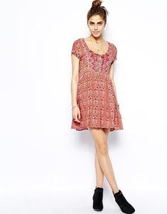 Image 4 ofFree People Sundown Babydoll Dress in Floral Print