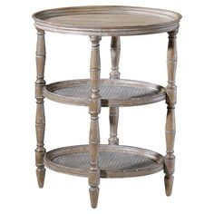 Weathered hardwood end table with two caned shelves and hand-turned legs.  Product: End tableConstruction Material: ...