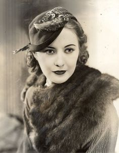 Barbara Stanwyck. Pure elegance <3 such a lovely hat and fur stole.