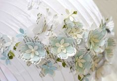 Martha Stewart Wedding flowers and Melissa Frances blue Crepe Paper and Pearl embellishments to make the flowers. The flowers were cut using AccuCut dies.