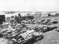 Caption   Dead Marines of the US 3rd Marine Division, covered by ponchos, Iwo Jima, Japan, Feb-Mar 1945  Source   United States Marine Corps  More on...   Battle of Iwo Jima