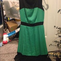 BNWOT Monteau sleeveless pleated skirt dress Cute green and black sleeveless pleated skirt dress that ties in the back Monteau Dresses