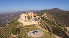 Malibu Rocky Oaks Estate Wine Club Pool party wine tasting event. Helicopters, wine and vines. Maliburockyoaks.com