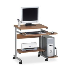 Easily move this compact and transportable computer desk wherever you need to be working at the moment. With thermally fused laminated surfaces and a steel frame, this wheeled desk is sturdy and durable. It has a slide out keyboard tray.