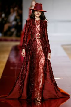 Zuhair Murad's long sheath dress in carmine lace with a matching coat in dupion , decorated with silk thread showered with crystals and beads.