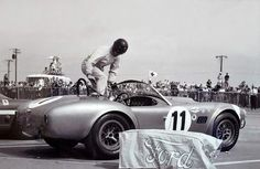 Dan Gurney goes over the door during the start of the  1963 Sebring 12HR.