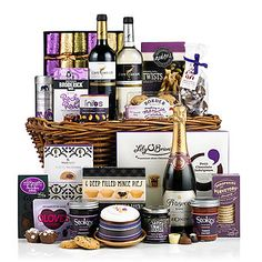 - This stunning-looking hamper will bring a touch of class to every Christmas get-together. Friends, family, customers and colleagues will all be treated to a feast for the eyes with this tasteful collection of luxury Christmas food and wine. Traditional Hampers, Wicker Hamper, Gifts For Colleagues, Christmas Hamper, Gift Hampers, Christmas 2014, Prosecco, Wine Recipes, Whiskey Bottle