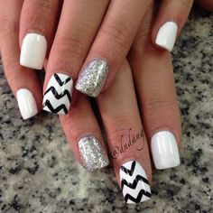 """""""Platinum!"""" - white square tip, with silver glitter on ring finger and white base with black tribal decal."""