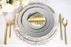 Pretty grey dinnerware paired with gold.