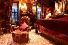Wellbeck velvet in Best claret on chairs and walls in the five star Prestonfield Hotel in Edinburgh