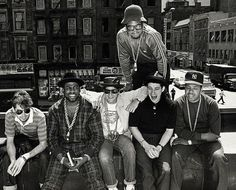 NYC early 1980s classic hip-hop. Black and white photo of  Run DMC and the Beastie Boys.