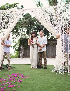 "Tie strips of muslin fabric together to make a dreamy outdoor ""entrance"" for the bride, maybe combine with leis"