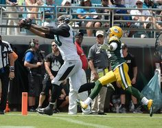 Jacksonville Jaguars tight end Julius Thomas, left, makes a catch for a 22-yard touchdown in front of Green Bay Packers cornerback Quinten Rollins, right, during the first half of an NFL football game in Jacksonville, Fla., Sunday, Sept. 11, 2016.