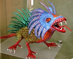 A colorful alebrije hisses at passersby in the Museo del Arte Popular.